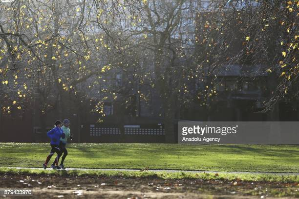 People run at Hyde Park during the last days of autumn on October 26 2017 in London England