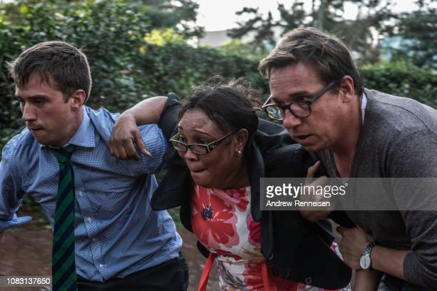 People run away from the Dusit Hotel after being rescued on January 15 2018 in Nairobi Kenya The man on the left was later identified as Australian...