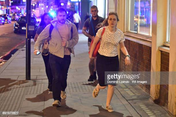 People run down Borough High Street as police are dealing with a quotmajor incidentquot at London Bridge