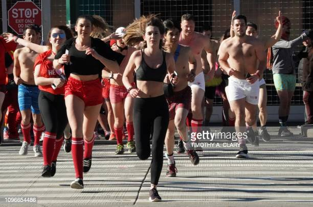 People run down the streets toward the West Side Highway as they take part in the Cupid's Undie Run February 9 2019 in New York Participants make the...