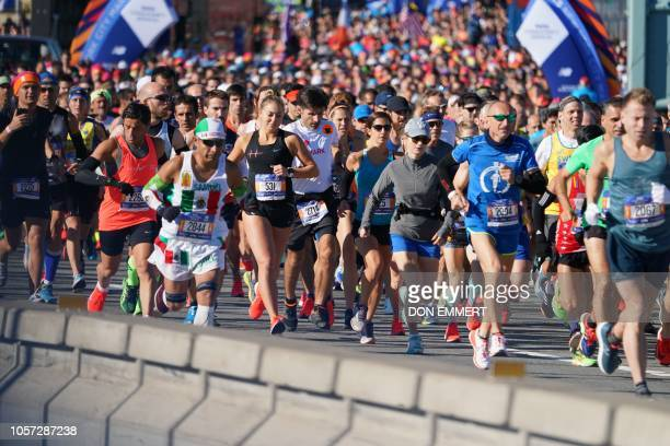 People run during the 47th running of the New York City Marathon on November 4 2018 in New York Twotime Boston Marathon champion Lelisa Desisa held...