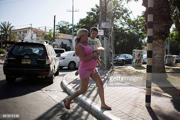 """People run for shelter during a """"color red"""" siren on July 10, 2014 in Sderot, Israel. Due to the recent escalation in the region, the Israeli army..."""