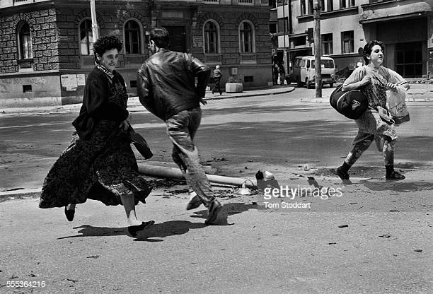 People run for their lives across 'Sniper Alley' under the sights of Serb gunmen during the siege of Sarajevo which lasted for 47 months and cost the...
