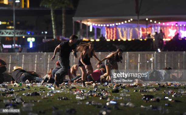 People run from the Route 91 Harvest country music festival after apparent gun fire was heard on October 1, 2017 in Las Vegas, Nevada. There are...
