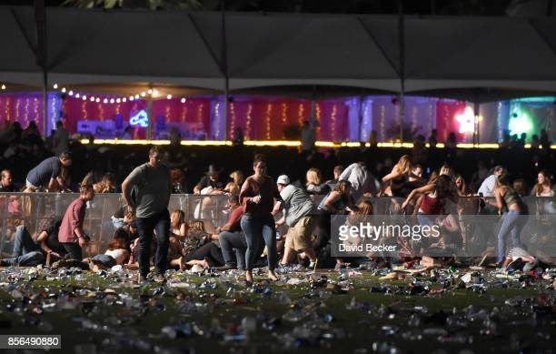 LAS VEGAS NV OCTOBER 01 People run from the Route 91 Harvest country music festival after apparent gun fire was heard on October 1 2017 in Las Vegas...