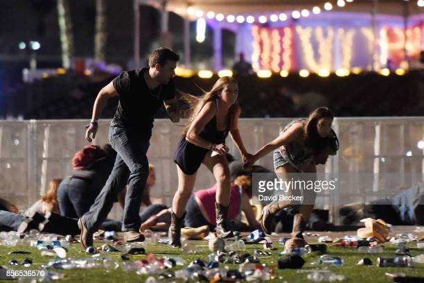People run from the Route 91 Harvest country music festival after apparent gun fire was hear on October 1, 2017 in Las Vegas, Nevada. A gunman has...