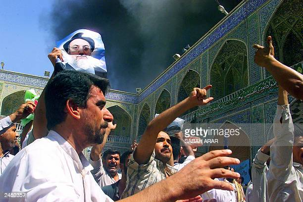 People run in panic 29 August 2003 inside the Shrine of Imam Ali one of Shiite Islam's holiest shrines in the central city of Najaf 180 km south of...