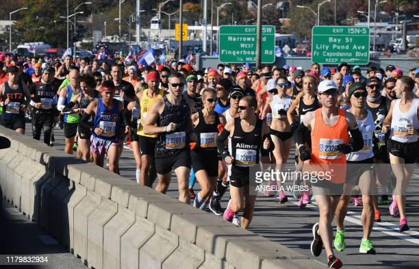 People run in the 2019 TCS New York City Marathon on November 3 2019 in New York Geoffrey Kamworor and Joyciline Jepkosgei sealed a double victory...