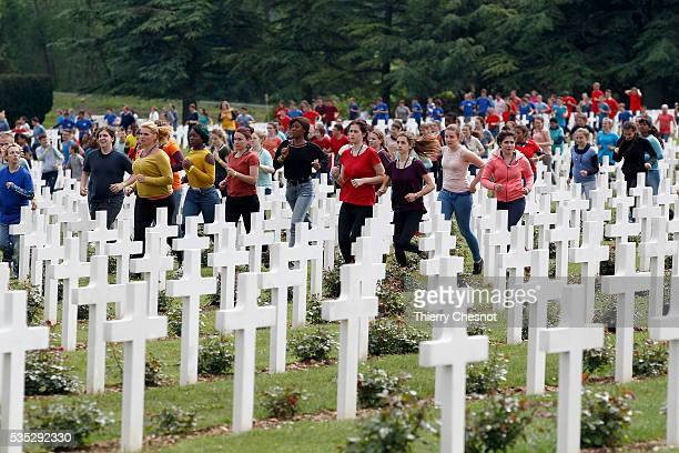 People run inside the French National cemetery outside the Douaumont Ossuary during ceremonies to commemorate the 100th anniversary of the World War...