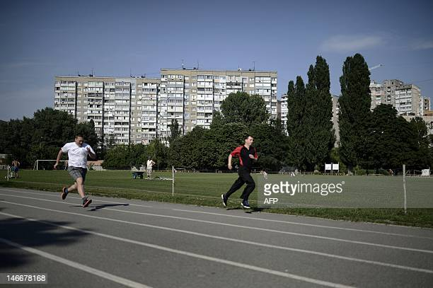 TOUCHOT People run on a track of the Start stadium on June 21 2012 in Kiev On August 9 45000 spectators attended a match in this stadium called Zenit...