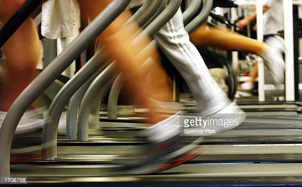 People run on treadmills at a New York Sports Club January 2 2003 in Brooklyn New York Thousands of people around the country join health clubs in...