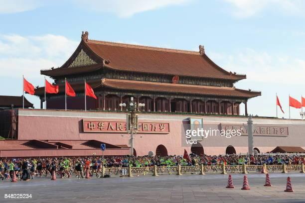 People run past the Tiananmen during the Beijing Marathon 2017 on September 17 2017 in Beijing China