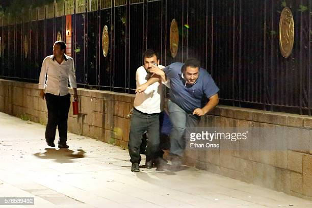 People run to escape from the clashes in Ankara July 16 Turkey Istanbul's bridges across the Bosphorus the strait separating the European and Asian...