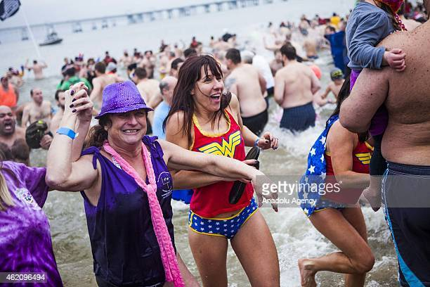 People run to escape the freezing water as even more run into it at the 19th Annual Maryland State Police Polar Bear Plunge at Sandy Point State Park...