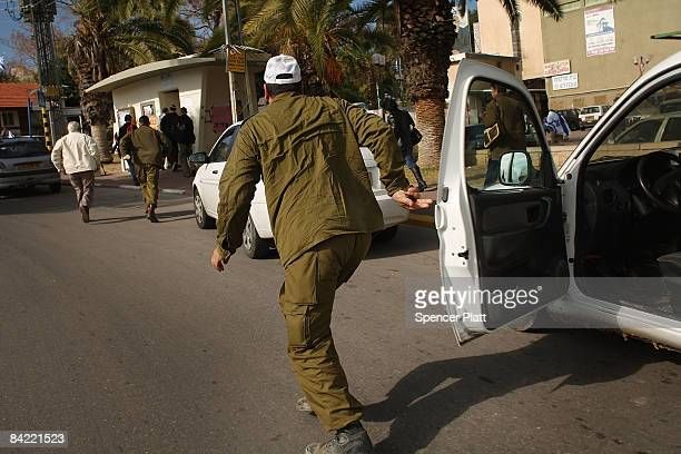 People run towards a bomb shelter January 9, 2009 in Sderot, Israel. The southern town of Sderot has had hundreds of Hamas fired kassam rockets...