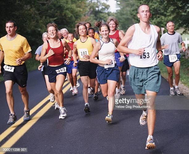 people running in road race - maratona foto e immagini stock