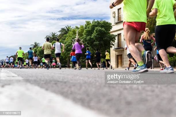 people running on road - marathon stock pictures, royalty-free photos & images