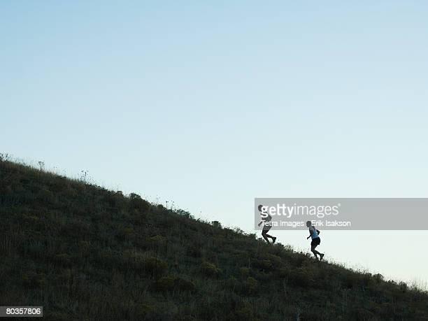 People running up mountain, Salt Flats, Utah, United States