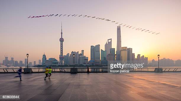 People running with flying kite in the morning, Shanghai
