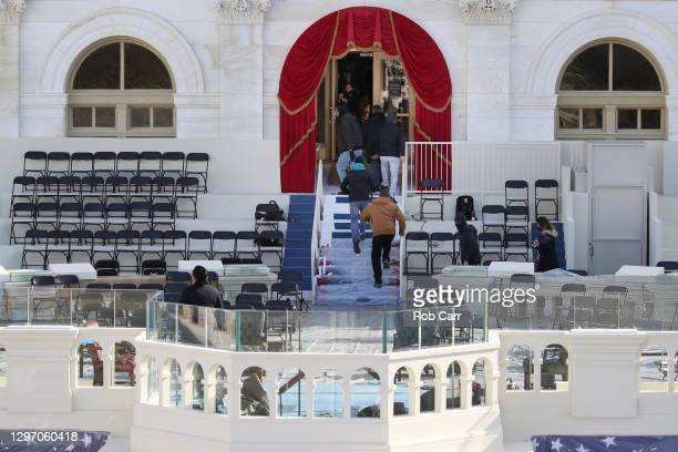 """People rush back in after an """"external security threat"""" forced an evacuation prior to a dress rehearsal for the 59th inaugural ceremony for..."""