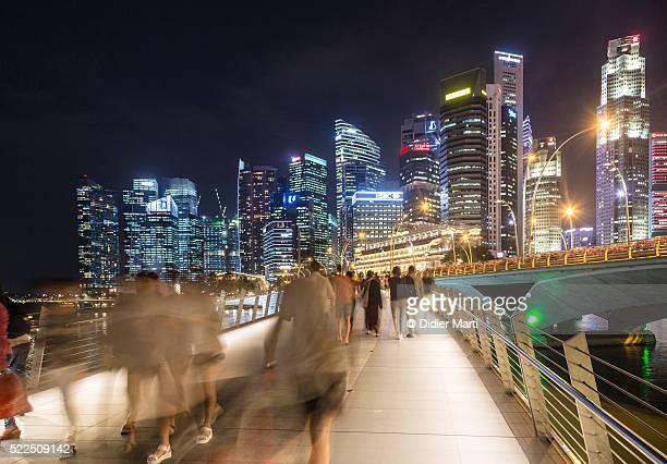 People rush in Singapore