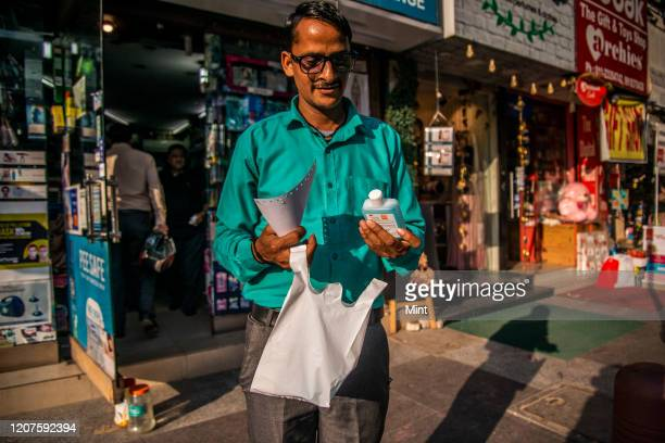 People rush to buy masks and hand sanitizers at pharmacy shop, Bangali Market, on March 3, 2020 in New Delhi, India. The virus has spread to more...