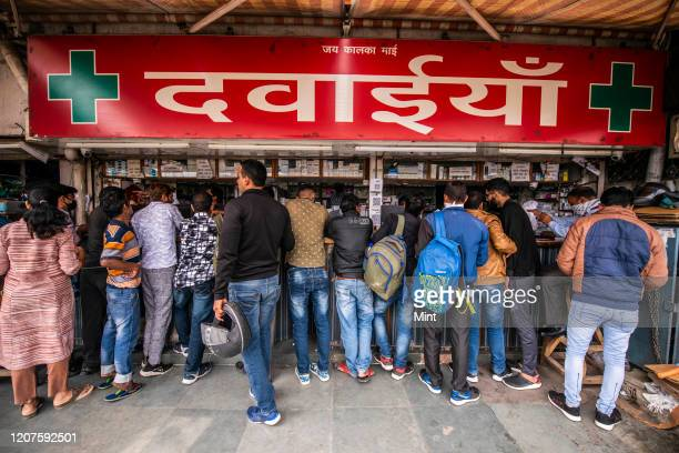 People rush to buy masks, hand sanitizers and medicines at pharmacy shop, AIIMS, on March 5, 2020 in New Delhi, India. The virus has spread to more...