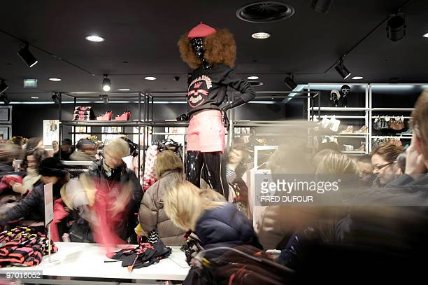 People rush to get clothes in a HM store stocking the new collection designed by redhaired 79yearold French designer Sonia Rykiel for HM on February...