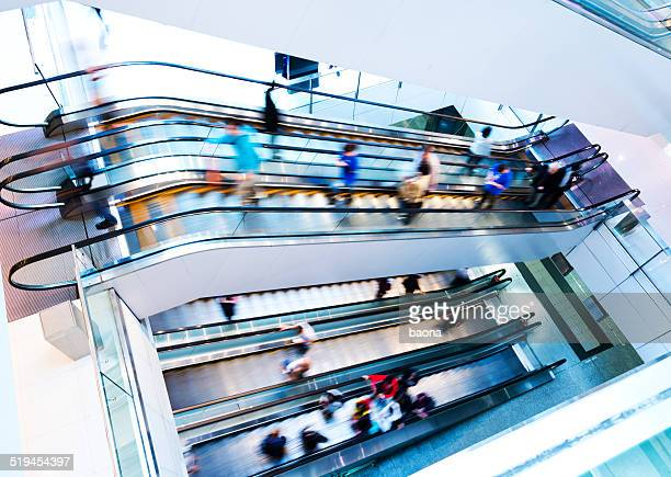 people rushing in escalators