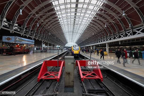 CONTENT] People rushing on Paddington station one of the oldest and most beautiful train stations of London The image consists of a symmetrical...