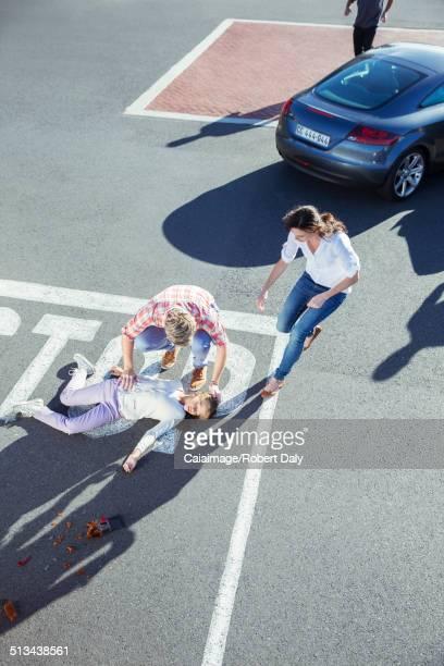 People rushing to injured girl on street