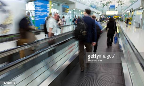 People rushing trough the airport of Bangkok people on a moving walkway