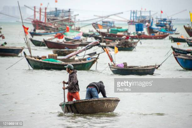 people sailing in a basket boat near the beach danang,vietnam - south vietnam stock pictures, royalty-free photos & images