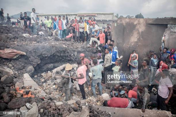 People salvage for their belongings in the aftermath of the eruption of the Nyiragongo volcano on May 24, 2021 in Goma, Democratic Republic of Congo....