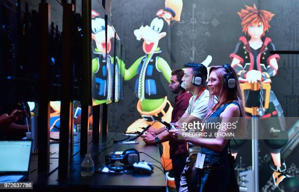 People sample te game Kingdom of Hearts by Disney and Square Enix at the 24th Electronic Expo or E3 2018 in Los Angeles California on June 12 where...