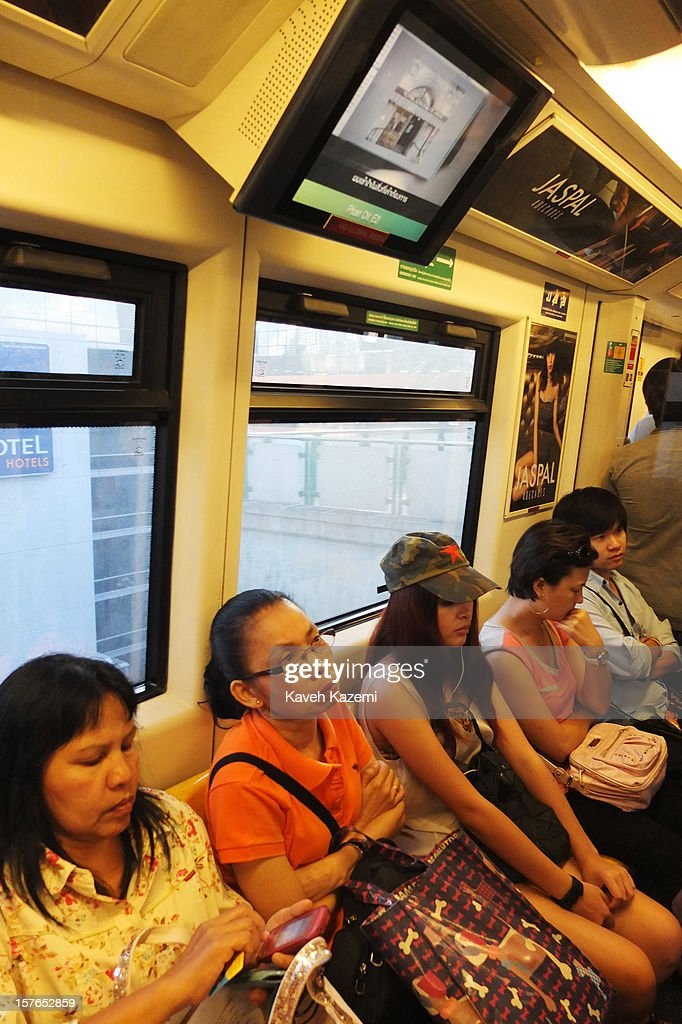 People sat on the sky train on October 25, 2012 in Bangkok, Thailand.