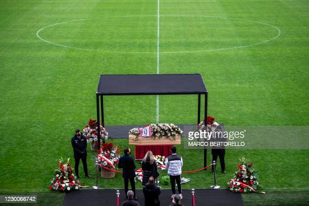 People say a final farewell to former Italys football player Paolo Rossi while his coffin is on public display in the Romeo Menti stadium in Vicenza,...