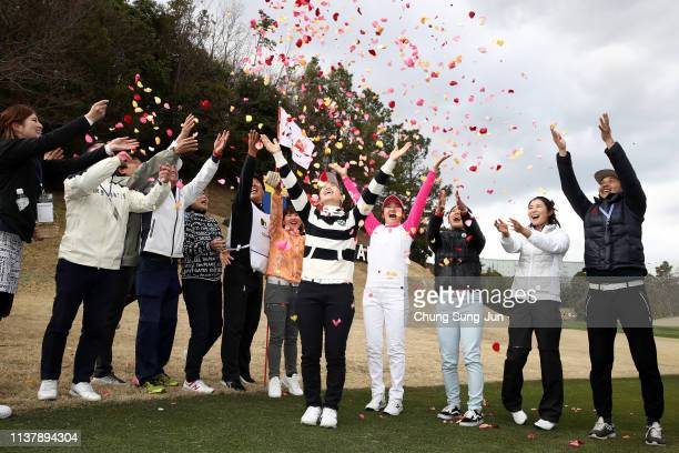 People scatter flower petals over Momoko Ueda of Japan during the ceremony following the TPoint x ENEOS Golf Tournament at Ibaraki Kokusai Golf Club...