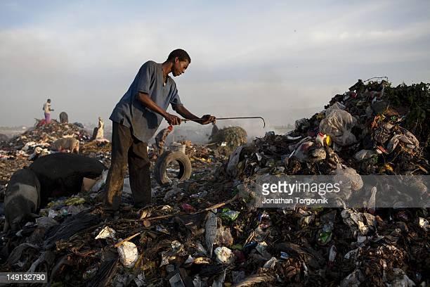 People scavenge through garbage at the maine human waist garbage dump near Cite Soliel slum January 2011 in Port-au-Prince, Haiti.