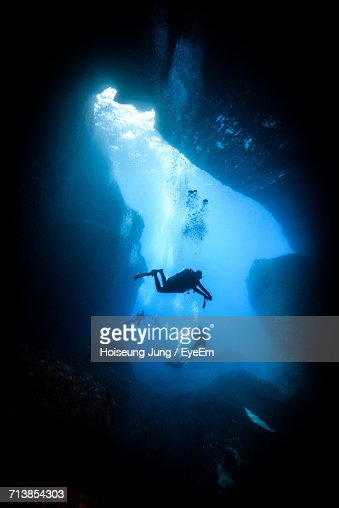 People Scuba Diving At Undersea
