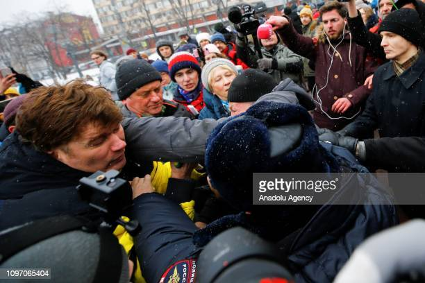People scuffle with Russian policemen during the 'Mothers' anger march' for the release of female political prisoners in Moscow Russia on February 10...