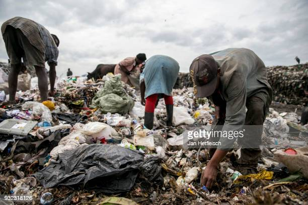 People search for plastic at the Dandora rubbish dump on March 14 2018 in Nairobi Kenya The Dandora landfield is located 8 Kilometer east of the city...