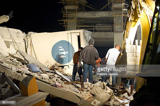 People search for survivors amongst the ruins of the childrens hospital following a major earthquake on January 13 2010 in PortauPrince Haiti A 70...