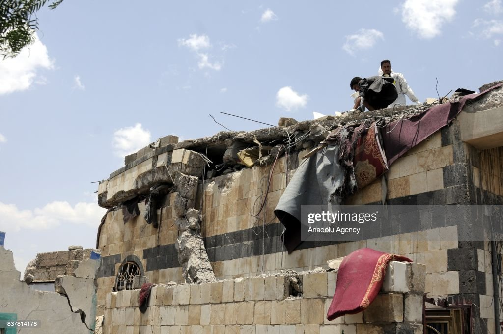 People search for survivors and death bodies at a heavily damaged building after Saudi-led coalition's air strikes over Arhab District of Sanaa, Yemen on August 23, 2017. At least 20 Shia Houthi militia group members were killed due to the attack.