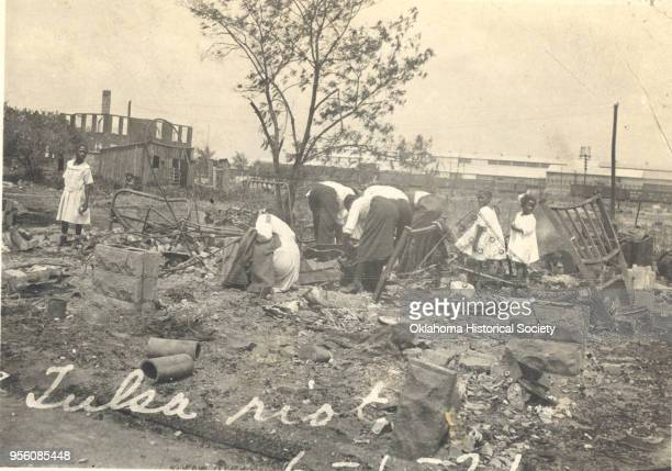 Photograph of people searching through rubble after the Tulsa Race Riot Tulsa Oklahoma June 1921