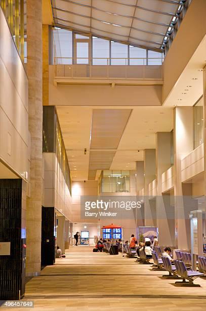 People seated in huge airport atrium