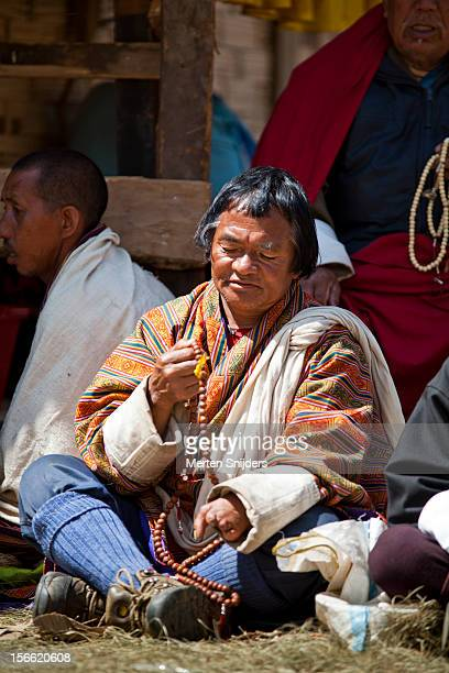 people seated while participating in teachings - merten snijders photos et images de collection