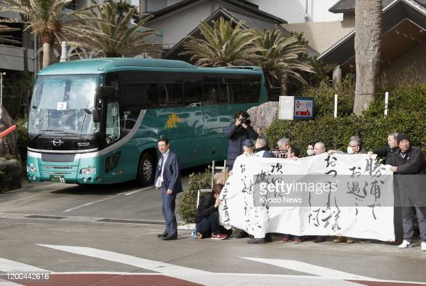 People see off a bus carrying evacuees from Wuhan the epicenter of the new coronavirus outbreak in China as it leaves a hotel in Katsuura Chiba...