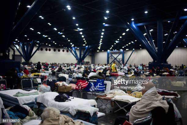People seek shelter at the George R Brown Convention Center in Houston Texas after Hurricane Harvey on Wednesday August 30 2017 John Taggart for The...