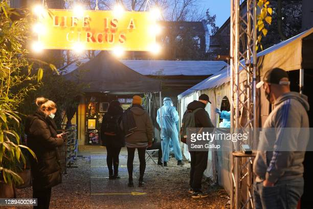 People seeking a rapid antigen Covid test arrive at a testing station set up on the grounds of the KitKat Club during the second wave of the...